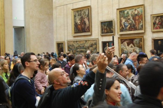 The crowds (and selfie sticks) for the Mona Lisa